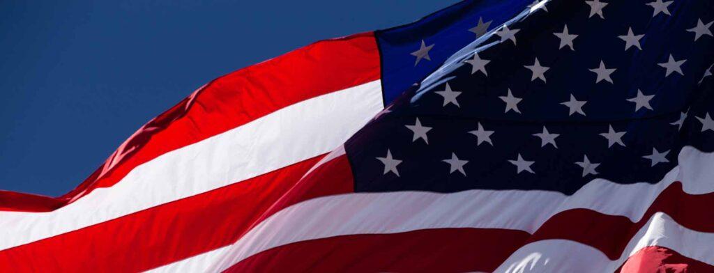 Waving American flag (Photo by Ben Mater on Unsplash)