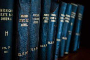 Law books on the shelf (Photo by Rob Girkin on Unsplash)