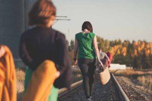 Refugees walking (Photo by Priscilla Du Preez on Unsplash)